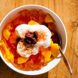Fruit jelly in bowl with whipped cream and raisin Royalty Free Stock Image