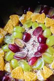 Fruit jelly cake with oranges and  grapes preparation phase Royalty Free Stock Photos