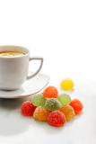 Fruit Jelly Candies and a Cup of Tea Stock Images