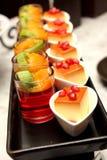 Fruit jelly with caramel custard on black Plate. A fruit jelly with caramel custard on black Plate royalty free stock photos