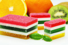Fruit jelly. Colored fruit jelly with fresh fruit sprinkled with sugar Stock Image