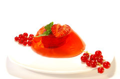 Fruit jelly decorated by strawberry Royalty Free Stock Images
