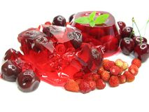Fruit jelly dessert with wild strawberry and cherry Stock Images