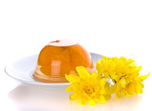 Fruit jelly and flowers. Royalty Free Stock Photos