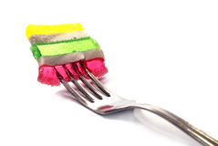 Fruit jelly and fork. Fruit jelly on the fork Stock Photo