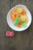 Fruit jelly hearts on wooden table Stock Photos