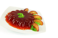 Fruit jelly with plums and mint Royalty Free Stock Image