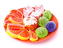 Fruit jelly on red plate Royalty Free Stock Images