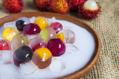 Fruit jelly. On the wooden table Royalty Free Stock Images