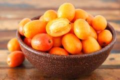 Fruit Jocote (Red Mombin, Purple Mombin, Hog Plum, Ciruela Huesi. To, Sineguela,  Siriguela) in brown bowl. Selective focus Stock Photo