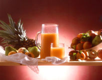 Fruit juice. Pictorial arrangement of fruits, carafe and glass Stock Photo