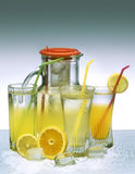 Fruit juice. Fresh and cold orange and lemon drink in glass with droplets stock photography