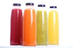 Fruit Juice. Colorful fruit juice bottles isolated on white Stock Images