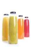Fruit Juice. Colorful fruit juice bottles isolated on white Royalty Free Stock Images