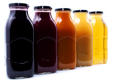Fruit juice. Bottles in row, made of natural fruits Stock Photography
