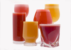 Fruit juice. Glasses of fresh juice from different fruit Royalty Free Stock Photos