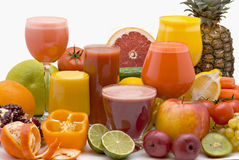 Fruit juice. Glasses of fresh juice from different fruit on a white background Royalty Free Stock Images