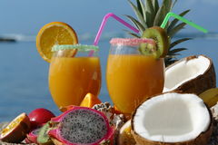 Fruit juice on the beach Royalty Free Stock Images