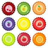 Fruit juice bottle caps. An illustration of metal fruit juice bottle tops in various colours, with fruit icon and condensation water drops Royalty Free Stock Photos
