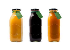 Fruit juice. Bottles in row, made of natural fruits with tags stock photos