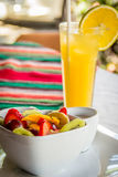 Fruit and Juice Breakfast. A breakfast platter combo consisting of fresh fruit and fresh orange juice stock image