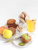 Fruit, juice and cookies.1. Kiwi, apples, cookies with a peanut, gingerbreads, juice Stock Images