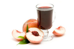 Fruit juice and fresh peaches Royalty Free Stock Images