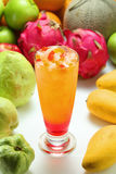 Fruit Juice. A glass of colorful fruit juice Stock Photography