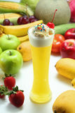 Fruit Juice. A glass of colorful fruit juice with ice-cream Stock Photography