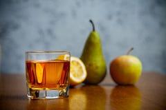 Fruit juice in glass Stock Photos