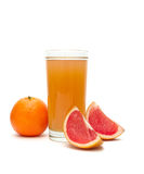 Fruit juice in a glass, tangerine and grapefruit on a white back Stock Image