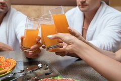 Fruit juice glasses on foregound croppped view Royalty Free Stock Photography