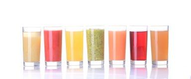 Fruit juice. ( grape , strawberries , orange , kiwi , grapefruit , apple )   on white background Royalty Free Stock Photos
