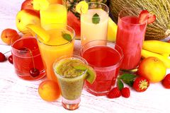 Fruit juice with kiwi, apricot, cherry, watermelon, tangerine and pear Royalty Free Stock Images