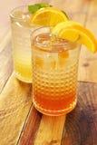 Fruit juice with lemon slices Royalty Free Stock Image