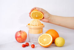 Fruit juice machine and hand Royalty Free Stock Images