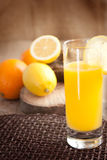 Fruit juice with oranges and lemons Royalty Free Stock Images
