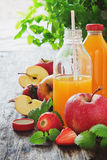 Fruit juice, ripe apples and strawberries Stock Photography