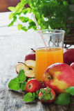 Fruit juice, ripe apples and strawberries Royalty Free Stock Images