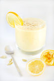 Fruit juice smoothie or milkshake with lemon and cardamom Royalty Free Stock Images