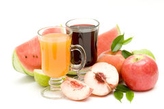 Fruit juice and some fresh fruits. On white stock photos