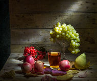 Fruit juice. Still life with grapes, apples, pears, viburnum and fruit juice Royalty Free Stock Photo