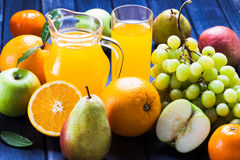 Fruit and juice still life, jug, glass, grape, pear, Apple, oranges Stock Photography