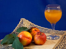 Fruit and juice. On the table isolated on a dark blue background Stock Images