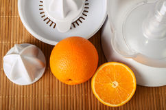 Fruit juicer and oranges Stock Photography