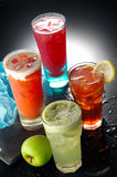 Fruit Juices. Four variety of fruit juices served in tall glasses Royalty Free Stock Images