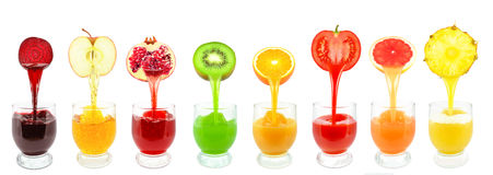 Fruit juices. Fresh fruit juices from flowing into the glass stock photos