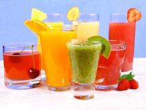 Fruit juices, kiwi, raspberries, cherry, orange, strawberry, pineapple Royalty Free Stock Photos