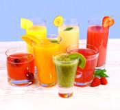 Fruit juices, kiwi, raspberries, cherry, orange, strawberry, pineapple Stock Images