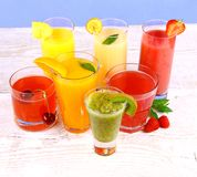 Fruit juices, kiwi, raspberries, cherry, orange, strawberry, pineapple Royalty Free Stock Photography